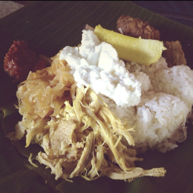 Nasi Liwet - a traditional food from Solo, Central Java. The rice is cooked in coconut milk, shredded chicken cooked in a mild coconut milk based sauce, egg pate and chayote vegetable. Traditionally served on a banana leaf.