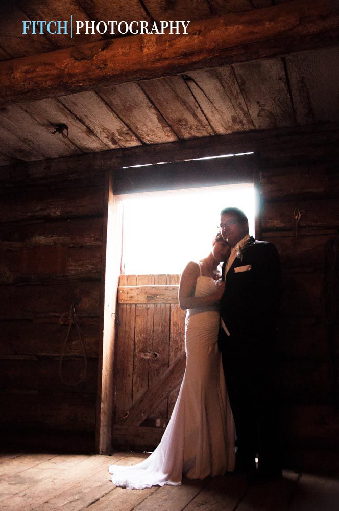 Hat Creek Ranch wedding in Cache Creek, BC.  Gorgeous shot in the stables...  Fitchphotography.com