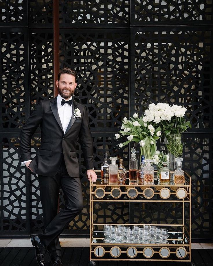 Groomsman, Mat, looking very dapper next to a well poured Whiskey Bar.  📷: @jeromecole.