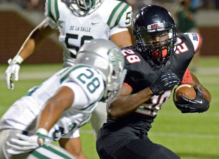Euless Trinity's Ja'Ron Wilson,right, gets around De La Salle's Antoine Custer for a first down in the first quarter of Saturday's August 29, 2015 football game at Newsom Stadium in Mansfield.   Special/Bob Haynes Photo: Bob Haynes / Special To The Star-Telegram / FORT WORTH STAR-TELEGRAM