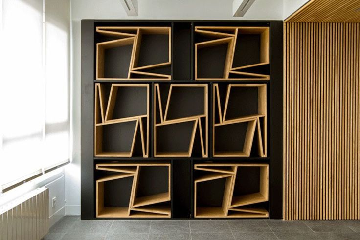 FLORES taller de arquitectura have design a pair of chairs that when stacked on top of each other they form a shape that can then neatly be stored away in a custom designed wall.