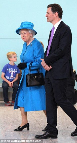 6/23/2014: John Holland-Kaye shows Queen Elizabeth II around the new Queen's Terminal at Heathrow (Hillingdon, London)