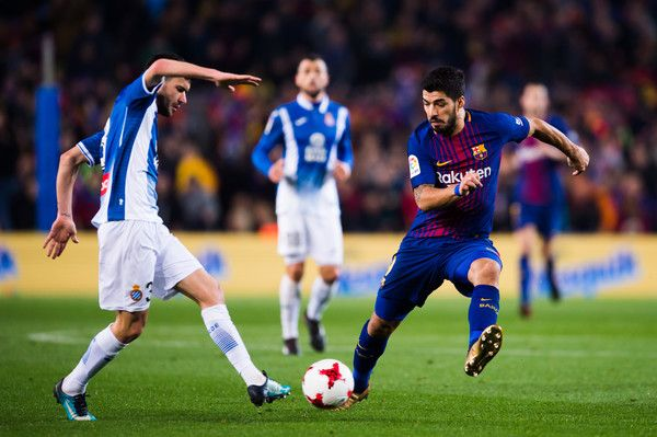 Aaron Martin of RCD Espanyol plays the ball under pressure of Luis Suarez of FC Barcelona during the Spanish Copa del Rey Quarter Final Second Leg match between FC Barcelona and RCD Espanyol at Camp Nou stadium at Camp Nou on January 25, 2018 in Barcelona.