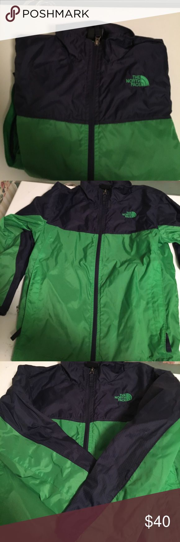 Boys North Face jacket size 10/12 Navy & Green lightweight jacket - best for cool spring or rainy weather. Front zipper. Used for two season but still in EUC.  Washes easily.  Inside tag has name and info ..... you could write over it or attach a new label. North Face Jackets & Coats Raincoats