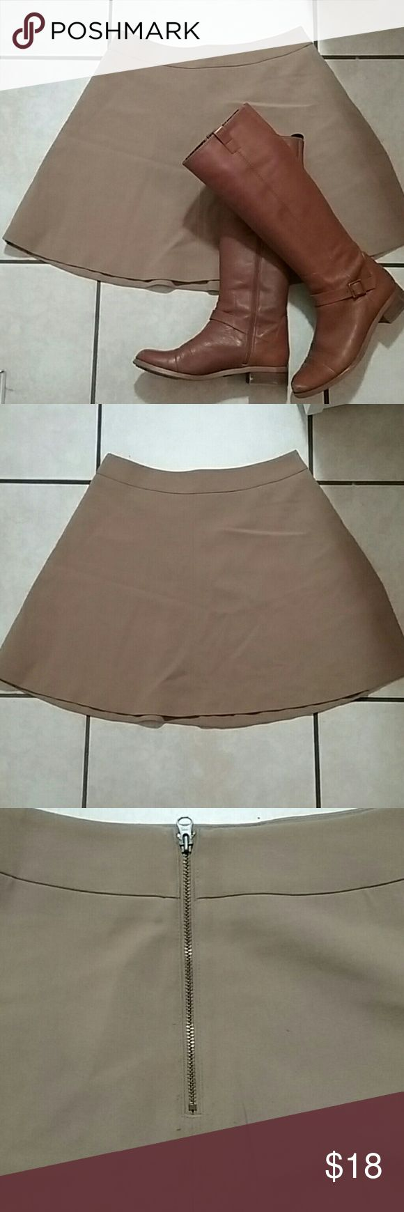 LOFT camel colored circle skirt LOFT camel colored circle skirt with exposed back zip. Sits at the waist and hits about 4 inches above knee. Some pilling at the butt area (see pics), overall euc. LOFT Skirts Mini