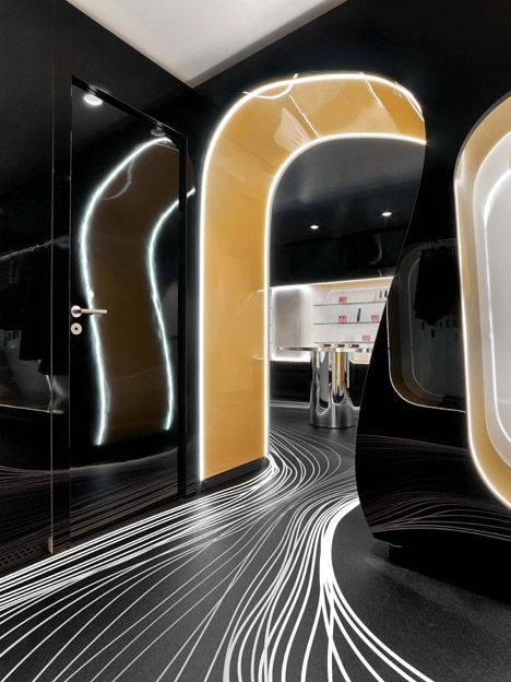 Fun Factory by Karim Rashid. LED lighting leeds the customer to the most important and interesting parts of the space