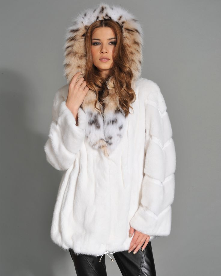 A wild beauty that never fades. Featuring a lynx cat fur jacket.