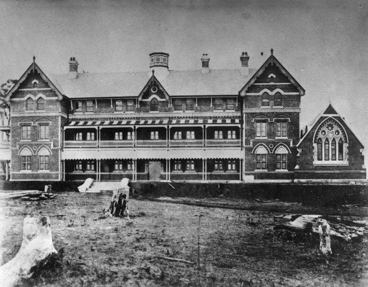 View of Toowoomba Grammar School, ca. 1876 - Toowoomba Grammar School was built in Gothic style, situated on 50 acres by Margaret, Mackenzie, Herries and Mary Streets. It was opened in 1876. Sir Charles Lilley laid the foundation stone on 5 August 1876.