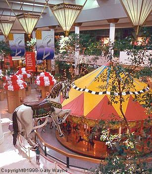 South Coast Plaza's Carousel Court I want to ride the merry go round with a balloon, because it makes everyone feel like a kid !