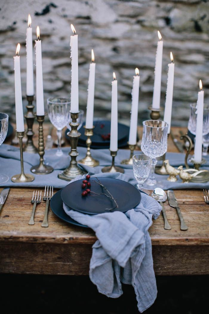Cozy up and enjoy this winter inspiration shoot where modern style meets medieval romance in a rich, moody color palette and a stunning black bridal gown.