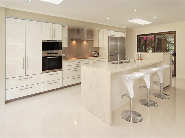 This kitchen won the Corian Design Award in 2010 and has been featured in several magazines. Doors are in Gloss laminate, benchtops in Corian with a Miele Steam Oven and Miele induction cook top.  www.kitchensbrisbane.com