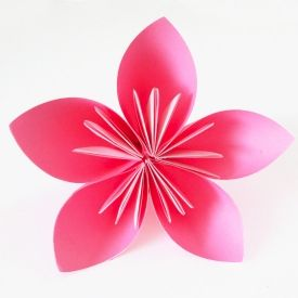 These simple origami flowers are made one petal at a time. Pretty and an easy way to get into the art of paper folding!