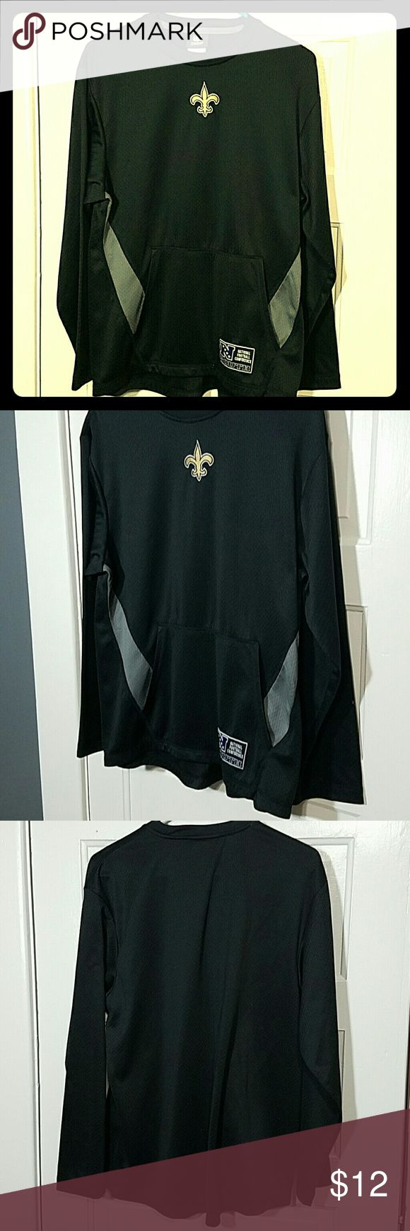 NFL Saints Long-sleeved Shirt Black with gray detail long sleeve shirt with Saints team logo stitched on front. National Football Conference South stitched on pocket.  See picture 4 for fabric detail - looks similar to a jersey.  Front kangaroo pocket. NFL Team Apparel Shirts Tees - Long Sleeve