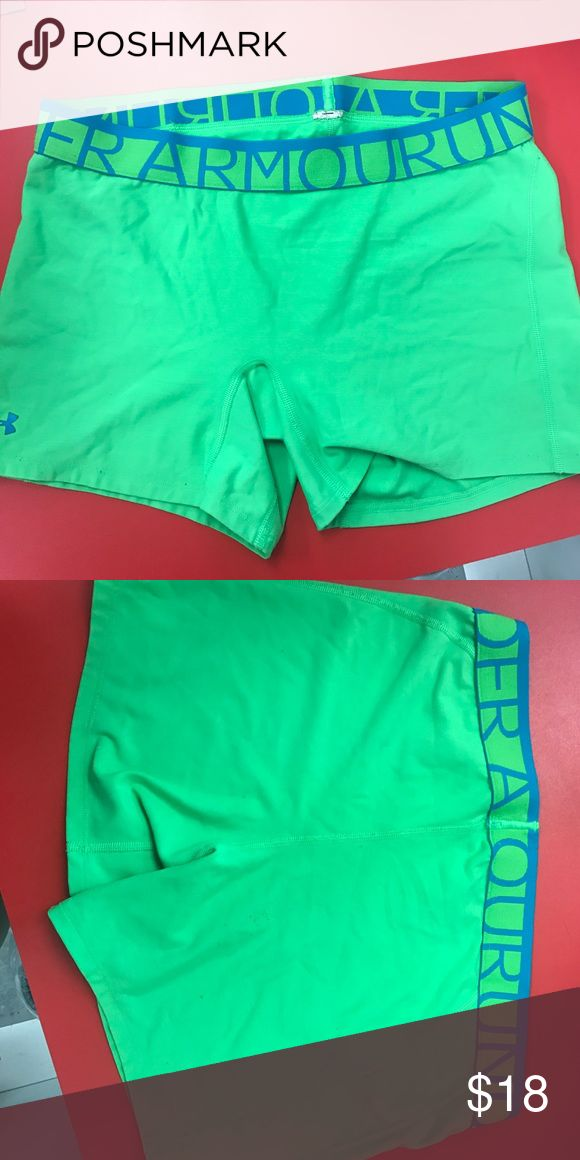 Under Armour lime green spandex shorts Lightly worn lime green with blue lettering on waistband. The tag has been cut out Under Armour Shorts