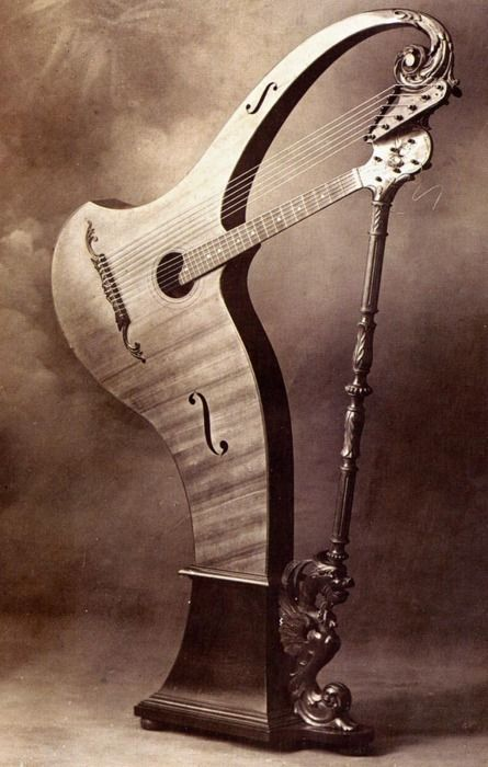 Cesare Candi harp guitar, date unknown - hahaha