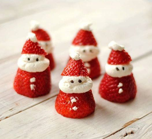 Adorable Santas All you need are strawberries, small marshmallows and chocolate sprinkles. Cut the bottom of the strawberry so that it stands up and make another cut just above the middle area. Stuff with a marshmallow and decorate as the picture shows.