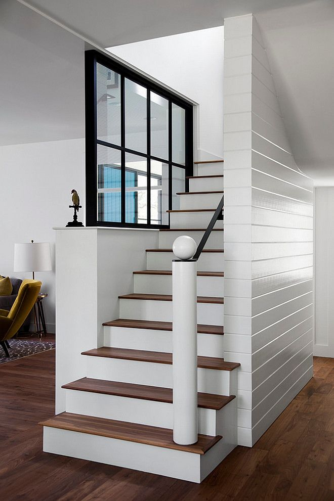 Now that's a staircase! V-groove, tongue and groove wood siding stairway. Window is walnut painted in black.