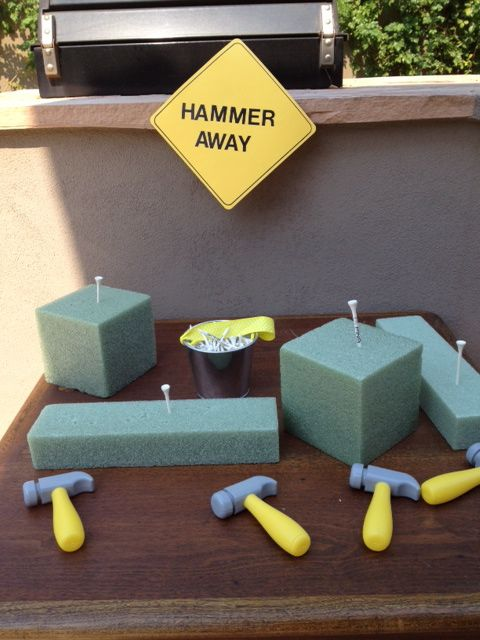 Golf tees into styrofoam blocks. Smart! and not noisy!