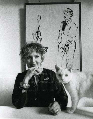 Celia Birtwell, textile designer, whose prints epitomized the '60s and '70s, sitting with her cat.