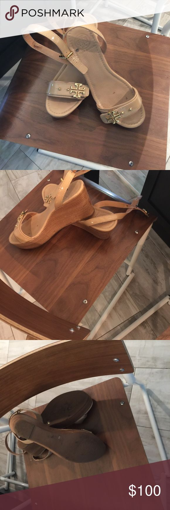 Tan wedges by Tory Butch Almost new Tory Butch wedge shoes . They are really cute .. only worn a few times . Please note that they are not perfect . One of the strap holders needs tobe repaired Tory Burch Shoes Sandals