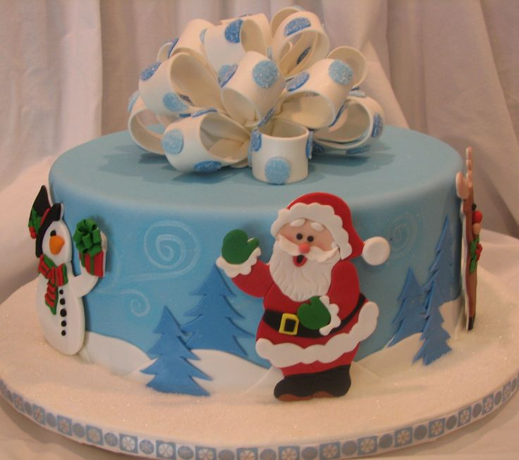 Winter Wonderland - The cake is done in fondant.  The trees and hills on the side are done in fondant.  The characters were cut by hand out of gumpaste.  The wind swirls were hand painted with luster dust and highlighted with light blue air brushing.  The loop bow was done out of gumpaste and accented with polka dots cover with white sanding sugar.   Patchwork cutters.