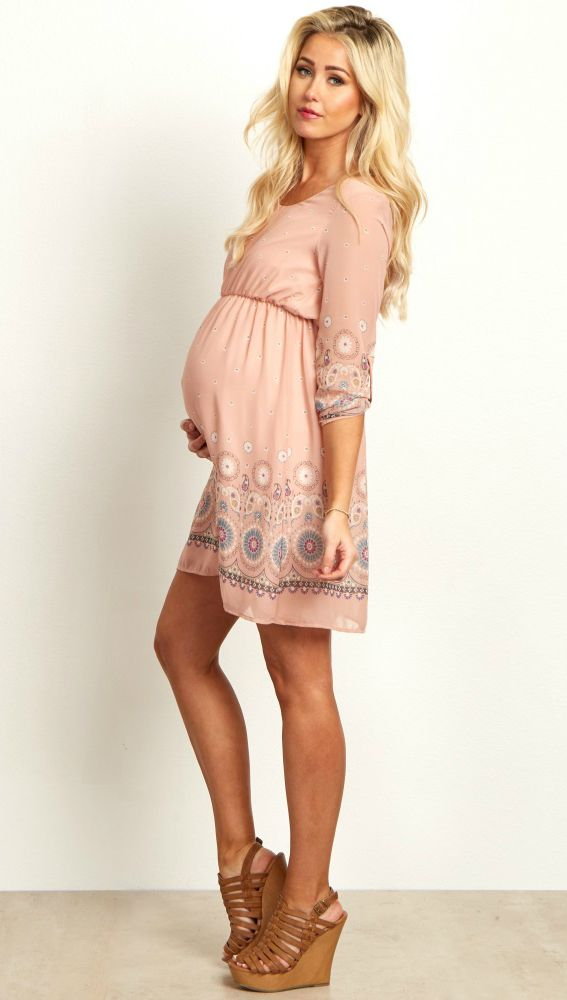 You can never have enough chiffon in your closet! We love this pretty chiffon maternity dress with a feminine mix of floral and paisley patterns. Gorgeous hues just in time for spring, you can style this maternity dress with wedge heels or boots for a complete look.