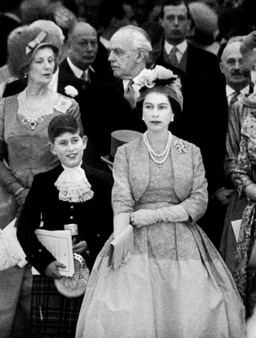 Queen Elizabeth II and son Prince Charles - amazing seeing this how much William looks like his dad. It always seemed like he favored his mom.