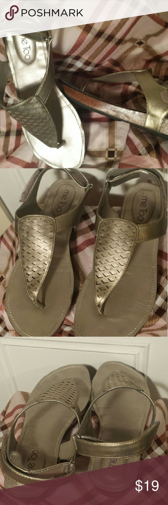 Me too Pewter Sandals.Sz.10M Super cute thong sandals by Me Too. Nice pewter metallic goldish color  Laser-cut details  velcro Loop closure  cushioned insoles. super comfortable!   Havent worn them in 2 Summer. They're in excellent condition retail $49    ************** No low ball offers will be acknowledged n No trades **************   happy poshing!! me too Shoes Sandals