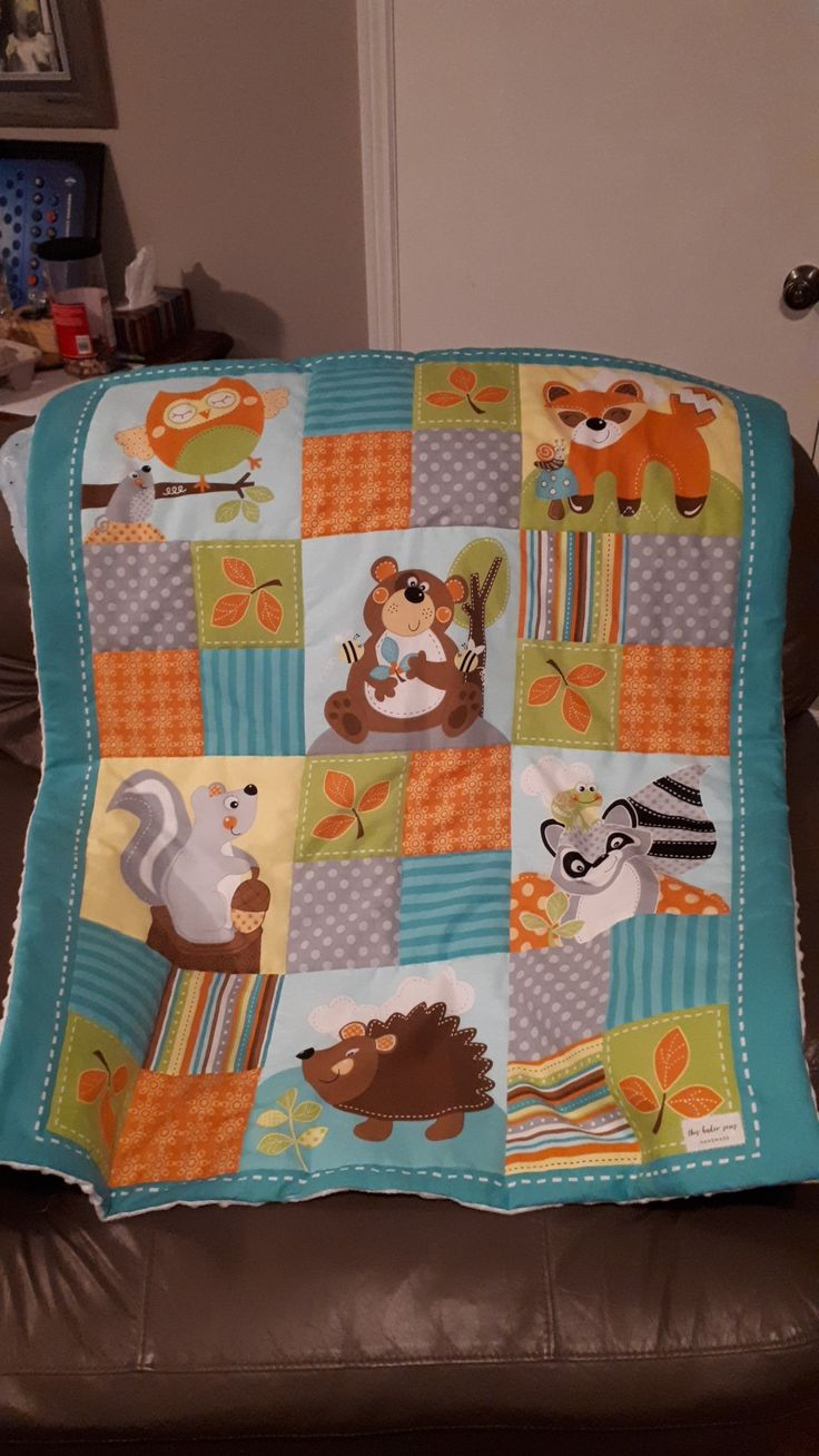 Panel from Joann fabric with white minky on the back makes a lovely baby blanket! I added batting then quilted around the squares