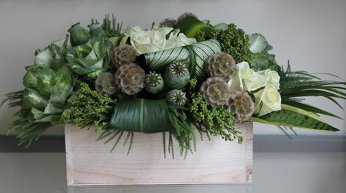 Masculine arrangement with scabiosa, poppy pods, kale, etc.