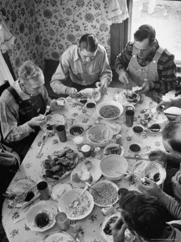 Vintage photo of farm hands eating lunch during harvest circa 1940. Notice the size of the plates. Small.