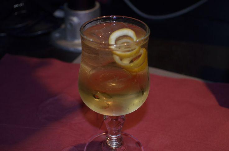 Lemon Blossom - gin, maraschino liqueur, & klein konstantine...topped with tonic with a lemon twist.