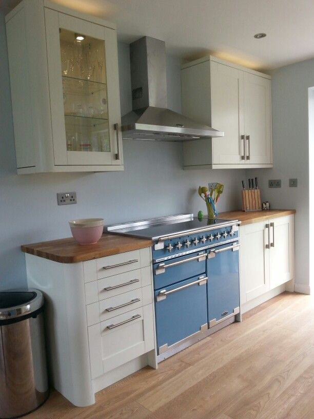 Blue Cooker, High Gloss White Kitchen, Wooden Floors And Worktops