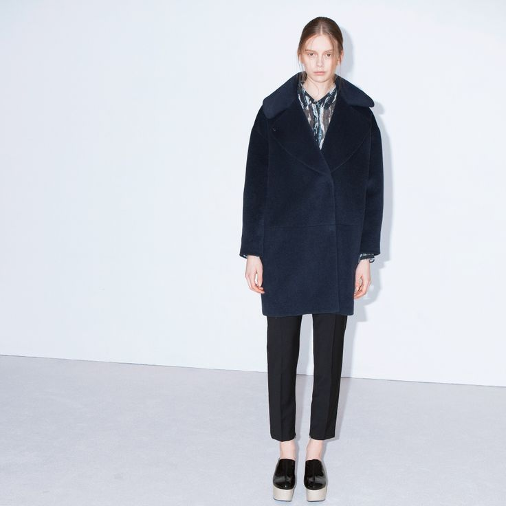 Falling is an oversized coat with classic features. Press buttons and in seam pockets at front.