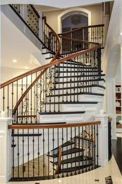 Cooper Stairworks   Unsupported stair with custom paneled stringers, black Indital balusters, mahogany rail, custom raised box newels.