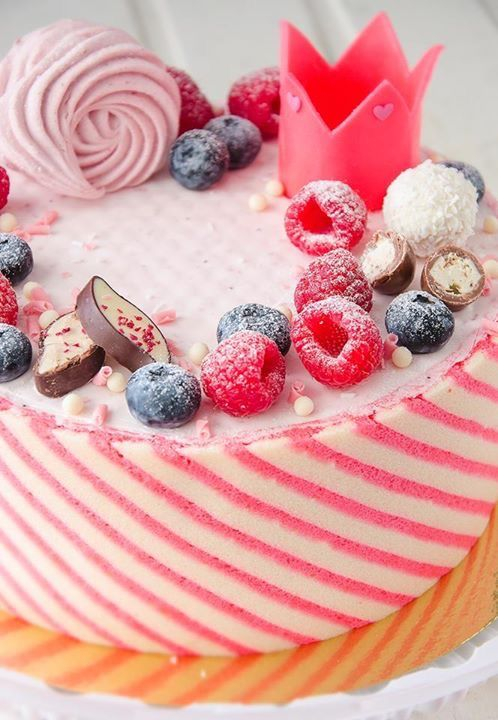 Striped rose mousse cake with berries