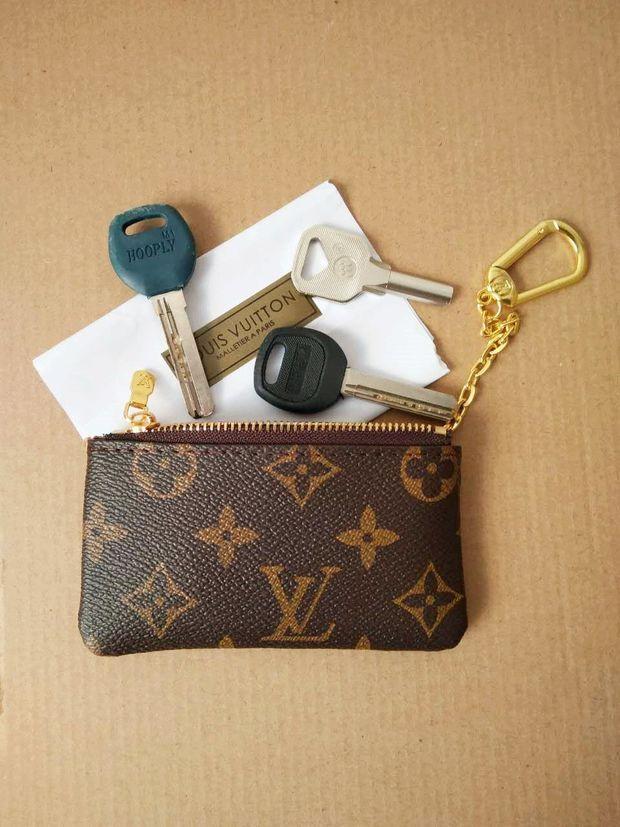 5e0ebe54a396 Louis Vuitton Monogram Canvas Key Pouch M62650