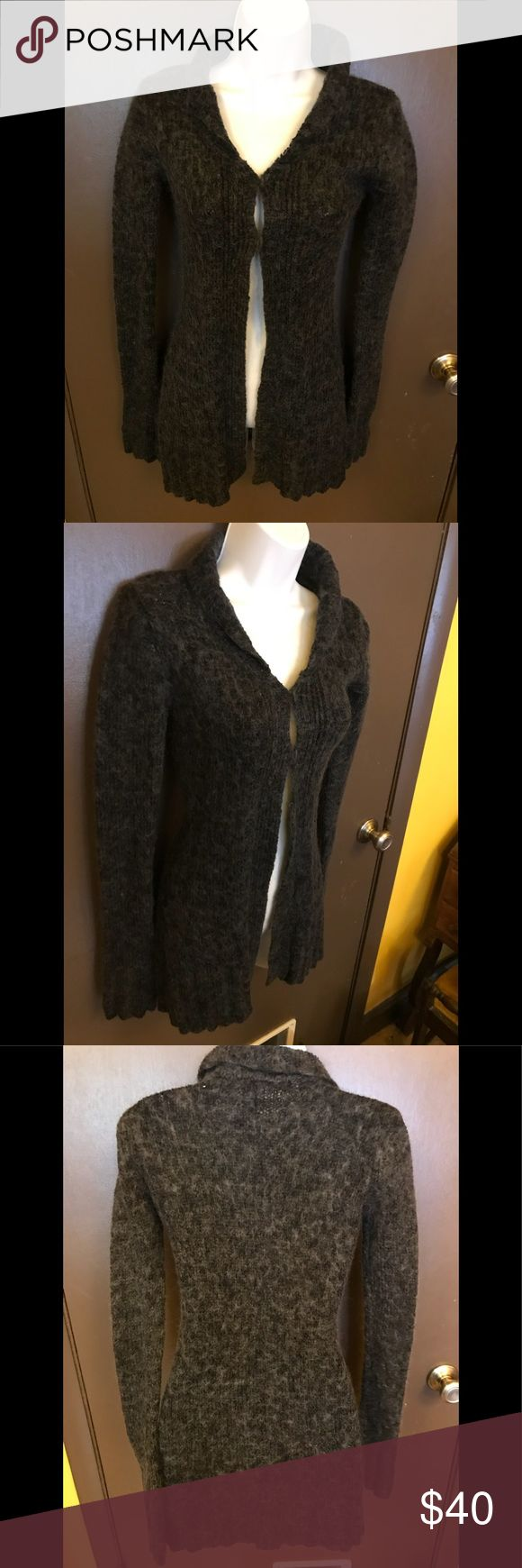 Witch Owned Free People Cardigan Sweater XS-Small Free People Charcoal Cardigan Sweater XS-Small. In my opinion fits XS better, but the tag says small. Two hook and eye closures at the top. Nice and warm. This is my sister in law's, who is a practicing witch. Free People Sweaters Cardigans