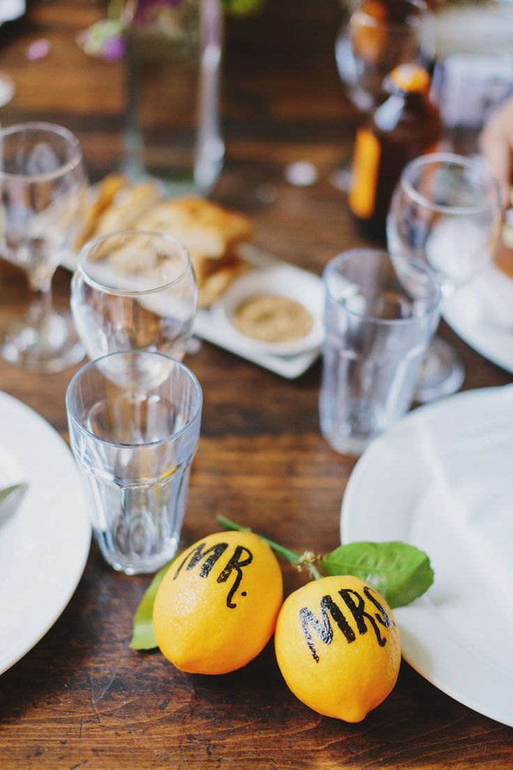 Fresh lemons doubled up as name place settings -  Image by Jonathan Ong Photography - Alice Temperley Bridal dress and a bride wearing glasses for a rustic wedding in Melbourne Australia by Jonathan Ong photography