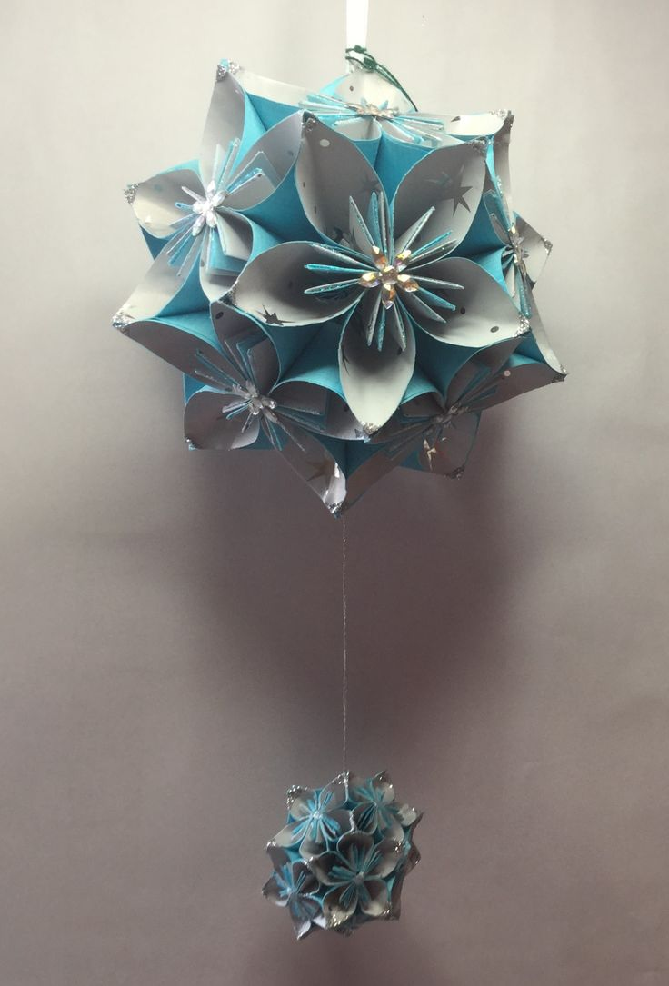 KO3 Light blue with star patterened inner petal ..14 cm sq. with small hanging kusudama of same pattern