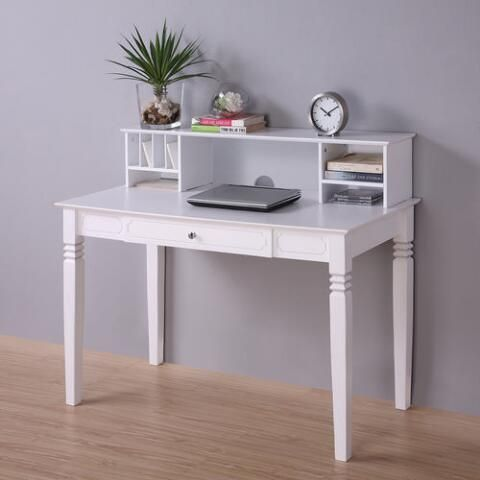 Featuring a hutch with storage compartments for extra organization, our desk is crafted of solid wood with a drop-down keyboard tray, metal pull, beveled desktop and front panel detail. Carved scrollwork accents the slightly tapered legs, and a sleek white finish makes this desk a charming addition to your home office.