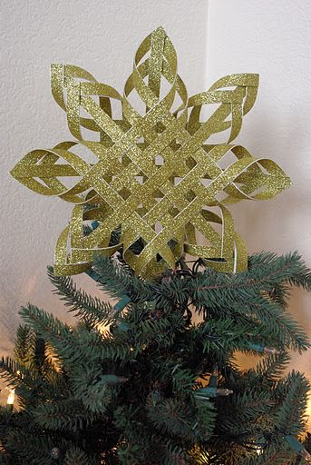 Turn glitter cardstock into a cool, star tree-topper!!  Printed card-stock would probably be cool, too!  It would be cool to make a bunch of these in different sizes and hang them from the ceiling or in the window!