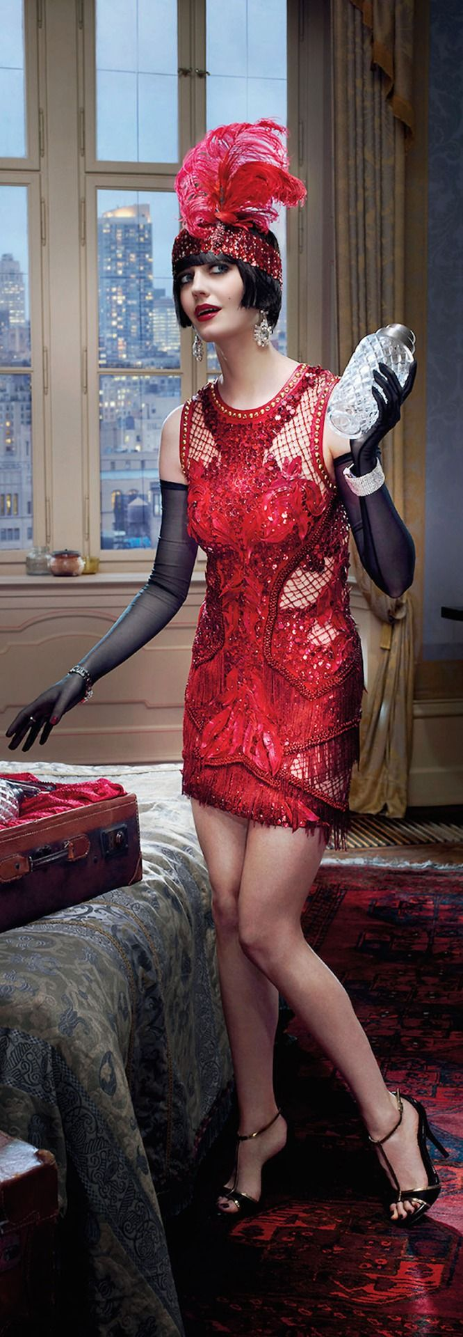 Eva Green for Campari Calendar 2015 wearing a Versace dress and Swarovski jewels.
