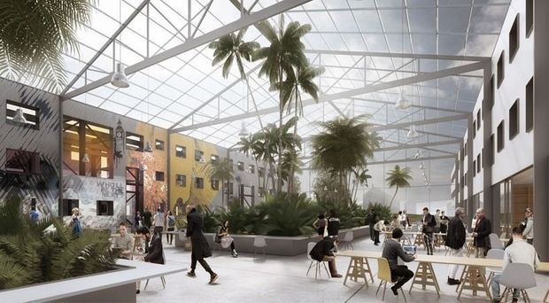 """Des architectes italiens transforment une ancienne militaire américaine située en Allemagne en communauté d'aujourd'hui, dont """"cohousing"""" et """"coworking"""" sont les maîtres mots."""