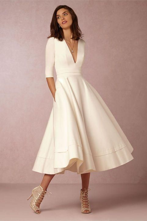 Brides looking for unique wedding dresses must check out BHLDN's spring 2016 collection. It's full of styles and cuts that are beautifully different (like this calf-length dress with a deep v-neck and sleeves that go to the elbows). Click for more!