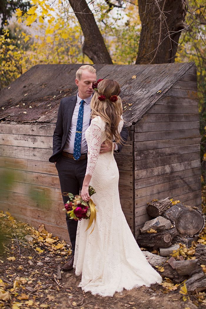 modest wedding dress with long lace sleeves. Love it for a late fall/winter wedding. photo - Alixann Loosle