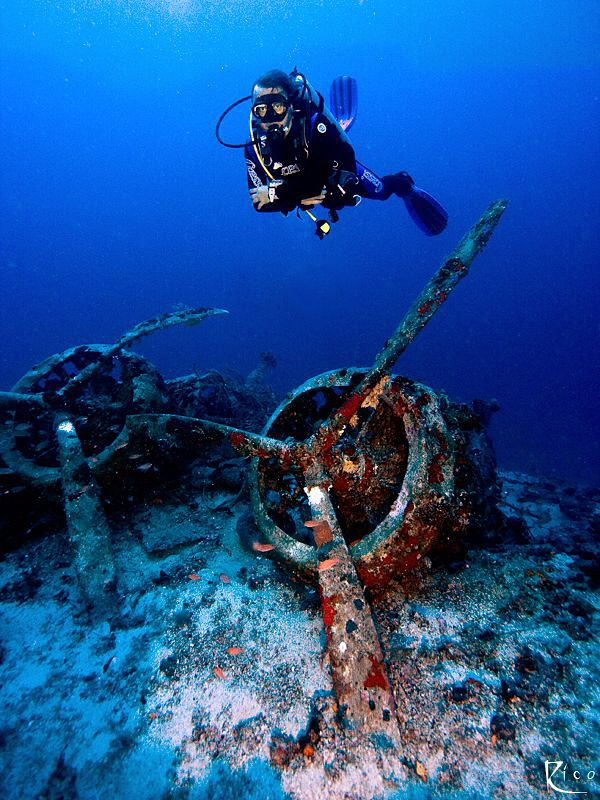 Deep dive to a sunken italian bomber airplane from the 2n... by Rico Besserdich.