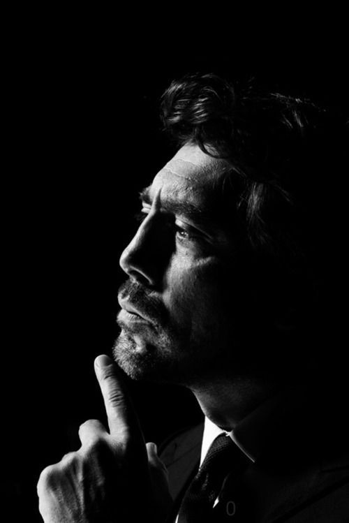 Javier Bardem. Low key. Single light source. Profile. Integrated hand. Tilt just a touch more to the left to lessen nose shadow and create clean profile at brow.