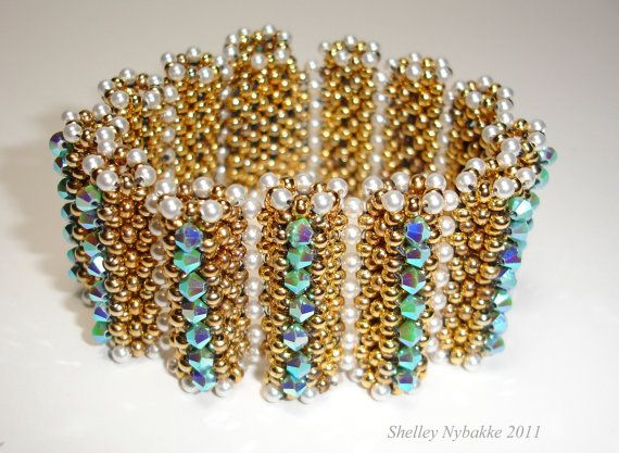 Tubes of Right Angle Weave put together in the most fabulous style. Embellished with 4mm crystals and 3mm pearls. Size 8/0 seed beads. Hidden snap clasp design