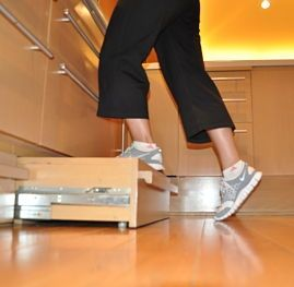 Steps cleverly placed in the toe-kick of lower kitchen cabinets give sturdy access to cupboards - genius!